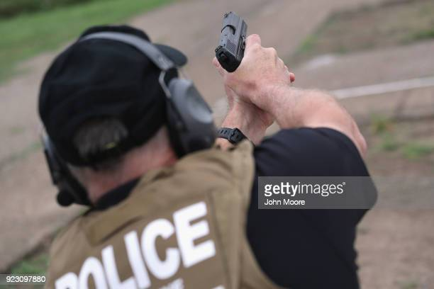 S Customs and Border Protection agent fires a HK P2000 handgun during a qualification test at a shooting range on February 22 2018 in Hidalgo Texas...