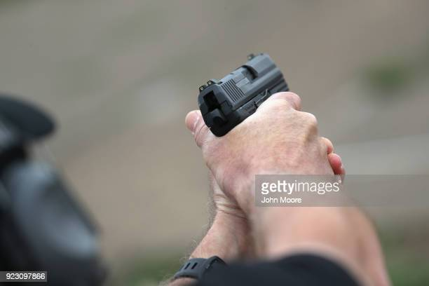 S Customs and Border Protection agent fires an HK P2000 handgun during a qualification test at a shooting range on February 22 2018 in Hidalgo Texas...