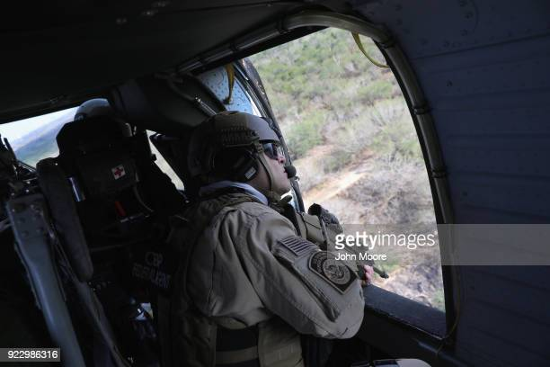 S Customs and Border Protection agent flies in a Black Hawk helicopter while pursuing a truck with suspected undocumented immigrants on February 21...