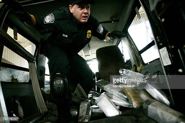 Customs and Border Protection agent Ian Bow exits a van after pulling out bricks of Marijuana at the U.S. Port of Entry December 15, 2006 in San...