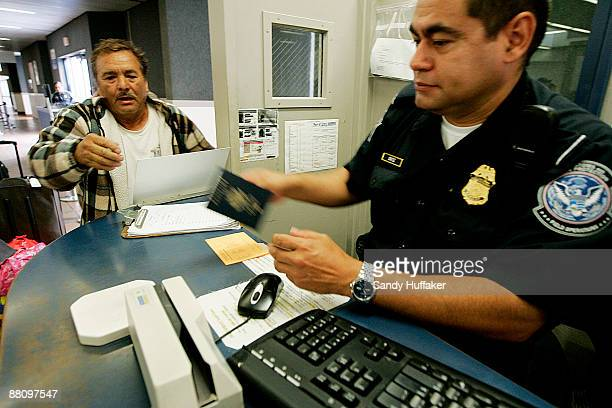 Customs and Border Protection agent Isaac Ortiz checks a passport from a pedestrian at the San Ysidro Port of Entry June 1 2009 in San Ysidro...