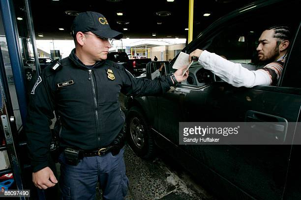 Customs and Border Protection agent Jesus Gomez check ID's from motorists crossing into the United States from Mexico at the San Ysidro Port of Entry...