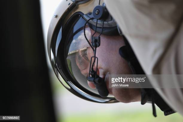 S Customs and Border Protection agent looks from a Black Hawk helicopter after landing from a patrol over the USMexico border on February 21 2018 in...