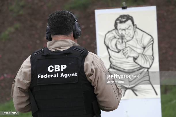 S Customs and Border Protection agent prepares to fire at a target during a qualification test at a shooting range on February 22 2018 in Hidalgo...