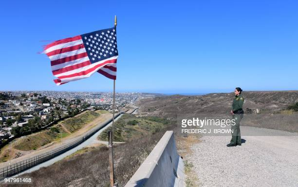 US Customs and Border Protection agent Tekae Michael stands at a lookout point overlooking the Border Infrastructure System a no man's land area...