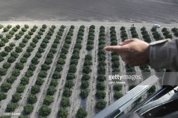 S Customs and Border Protection agent tracks undocumented immigrants from a helicopter patrol on November 6 2018 in McAllen Texas US Air and Marine...