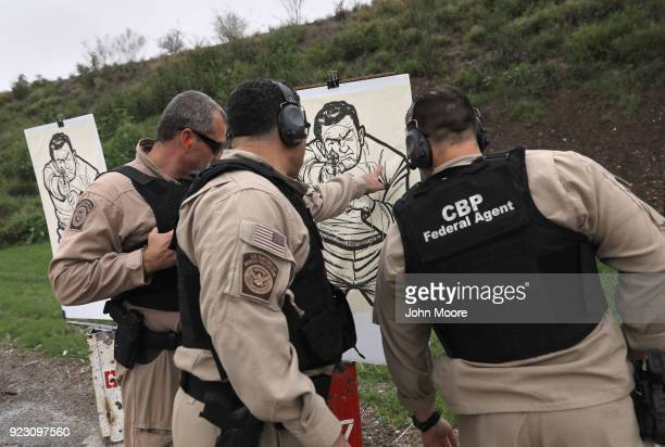 S Customs and Border Protection agents check a target during a qualification test at a shooting range on February 22 2018 in Hidalgo Texas CBP agents...