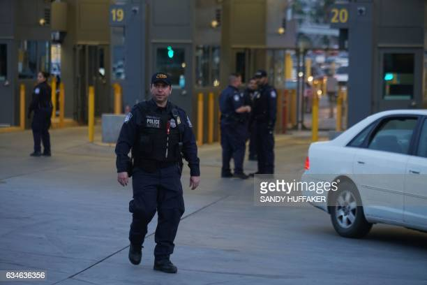 Customs and Border Protection agents check vehicles entering the United States at the San Ysidro Port of Entry in San Ysidro California on Friday...