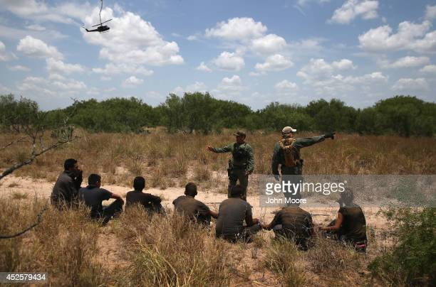 S Customs and Border Protection agents detain undocumented immigrants in dense brushland some 60 miles north of the USMexico border in Brooks County...