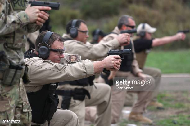 S Customs and Border Protection agents fire a HK P2000 handguns during a qualification test at a shooting range on February 22 2018 in Hidalgo Texas...