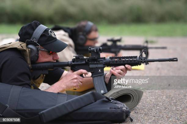 S Customs and Border Protection agents fire M4 rifles during a qualification test at a shooting range on February 22 2018 in Hidalgo Texas CBP agents...