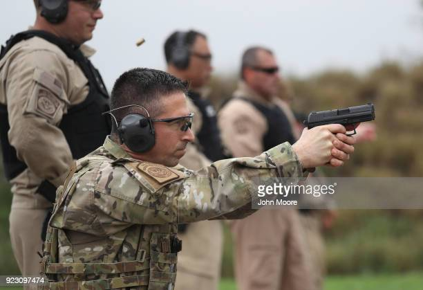 S Customs and Border Protection agents fires a handgun at a shooting range on February 22 2018 in Hidalgo Texas CBP agents must complete firearms...