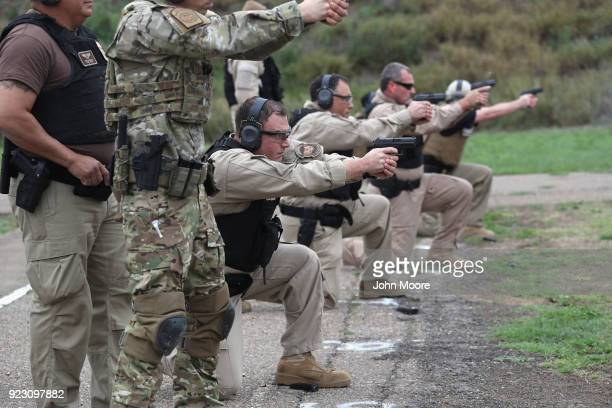 S Customs and Border Protection agents fires handguns at a shooting range on February 22 2018 in Hidalgo Texas CBP agents must complete firearms...