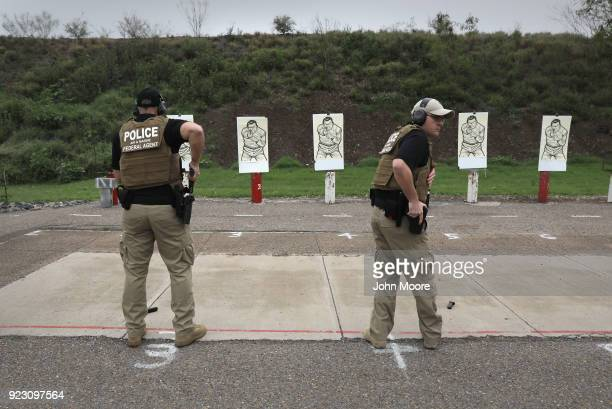 S Customs and Border Protection agents prepare to fire HK P2000 handguns during a qualification test at a shooting range on February 22 2018 in...