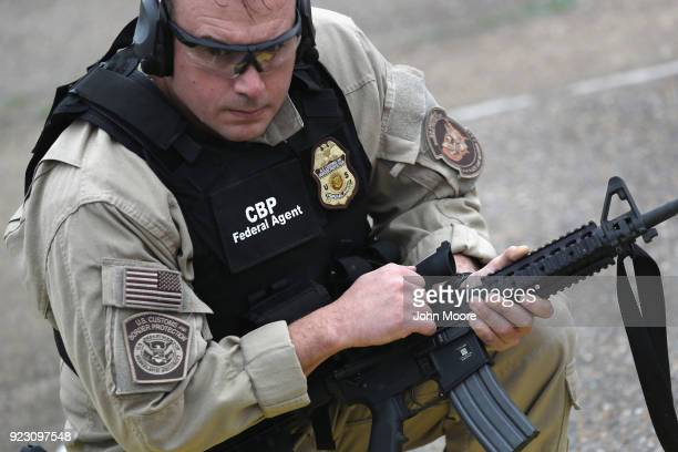 S Customs and Border Protection agents prepare to fire M4 rifles during a qualification test at a shooting range on February 22 2018 in Hidalgo Texas...