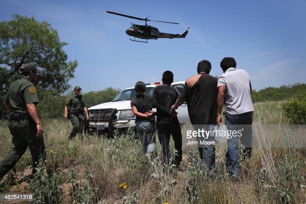 S Customs and Border Protection agents take undocumented immigrants into custody on July 22 2014 near Falfurrias Texas Thousands of immigrants many...