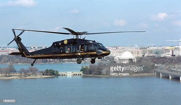 S Customs and Border Protection Black Hawk helicopter provides air security March 18 2003 as it flies over Washington DC The nation's terrorism alert...