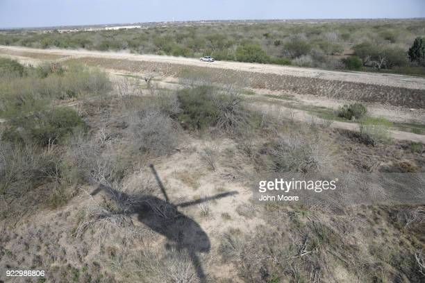 S Customs and Border Protection Black Hawk helicopter pursues a truck with suspected undocumented immigrants on February 21 2018 in McAllen Texas Air...