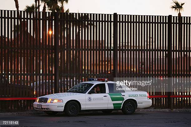 Customs and Border Protection border patrol officer next to the USMexico border fence looks for illegal immigrants on October 7 2006 in Calexico...
