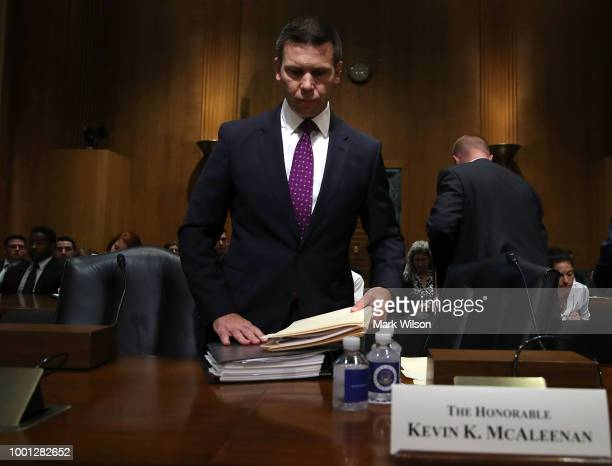 Customs and Border Protection Commissioner Kevin K McAleenan talks with Sen Rob Portman before a Senate Finance Subcommittee hearing on July 18 2018...