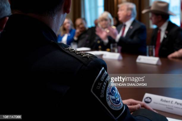 US Customs and Border Protection Deputy Commissioner Robert E Perez and others listen to US President Donald Trump during a meeting about border...