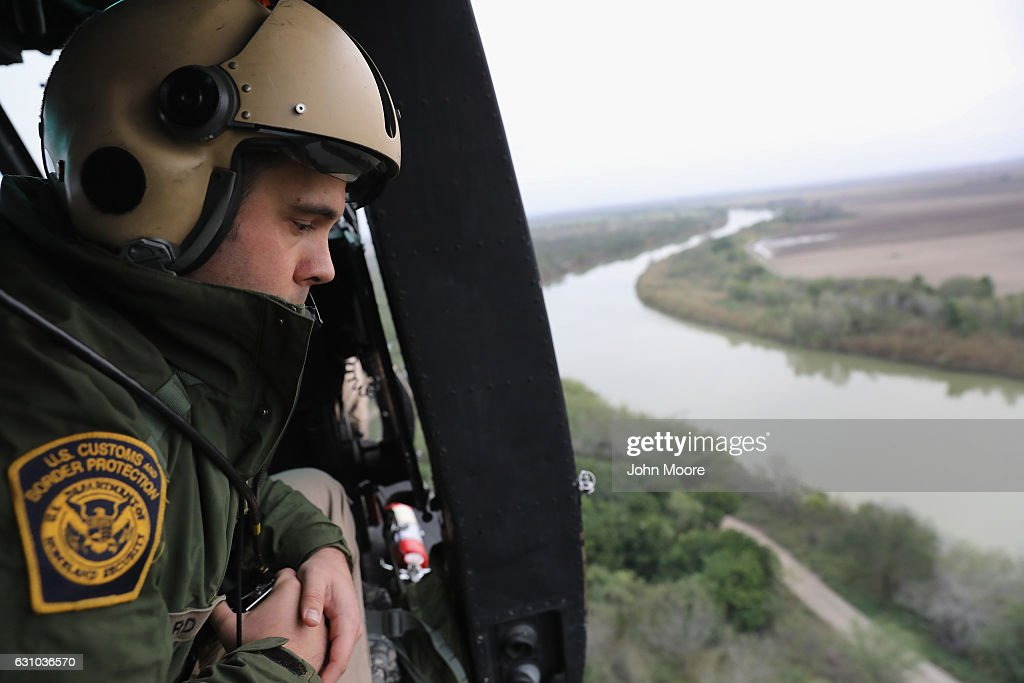 S. Customs and Border Protection helicopter crew searches for illegal immigrants along the Rio Grande at the U.S.-Mexico border on January 5, 2017 near La Grulla, Texas. The number of incoming immigrants has surged ahead of the upcoming Presidential inauguration of Donald Trump, who has pledged to build a wall along the U.S.-Mexico border.
