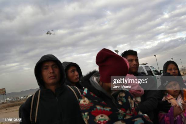 S Customs and Border Protection helicopter passes Central American immigrants after they crossed into the United States from Mexico on February 01...