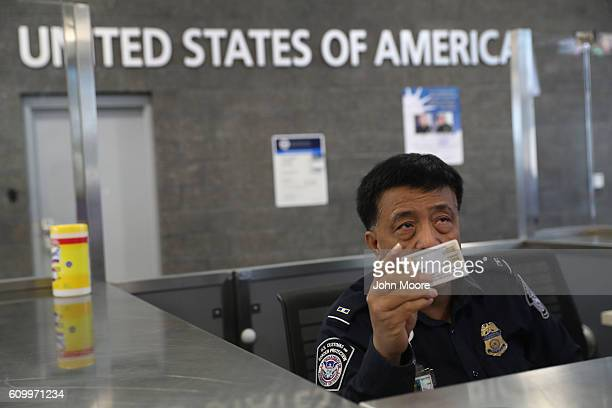 Customs and Border Protection officer checks identifications as people cross into the United States from Mexico on September 23, 2016 in San Ysidro,...