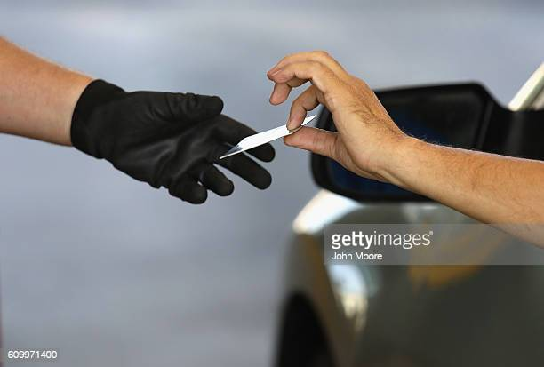 S Customs and Border Protection officer checks identifications as vehicles cross into the United States from Mexico on September 23 2016 in San...