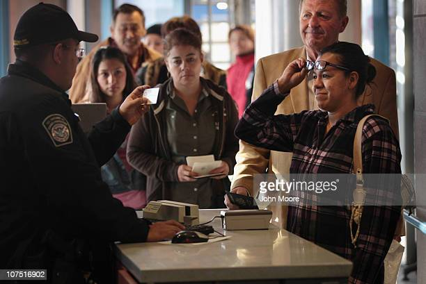 S Customs and Border Protection officer checks the IDs of visitors entering the United States from Mexico at the border crossing on December 10 2010...