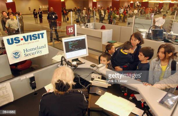 Customs and Border Protection officer Mary Armbrust uses the new USVISIT biometric program with the Guzman family from Chile at HartsfieldJackson...