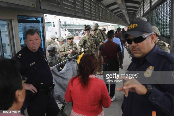 S Customs and Border Protection officers and US Army troops allow people to pass over the international bridge with Mexico to an immigration...