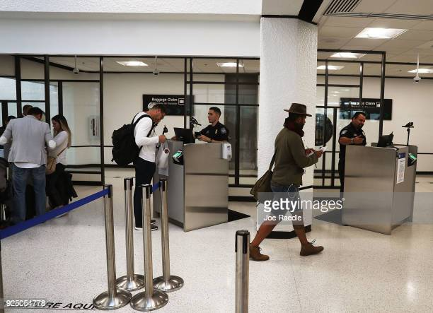 S Customs and Border Protection officers use facial recognition technology in their booths at Miami International Airport to screen travelers...