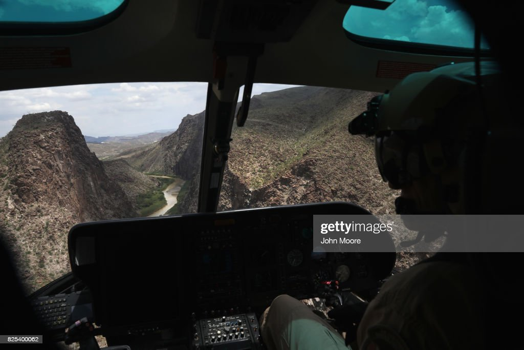 S. Customs and Border Protection pilot flies a helicopter patrol along the U.S.-Mexico border on August 1, 2017 near Lajitas, Texas. Logistical challenges, such as the rugged terrain of west Texas' Big Bend region are just some of the complications facing the construction of a border wall proposed by President Trump.
