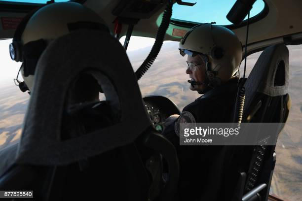 S Customs and Border Protection pilots fly over the Big Bend area of west Texas on November 22 2017 near Van Horn Texas Federal agents are searching...