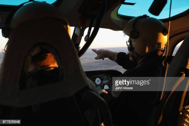 S Customs and Border Protection pilots fly over the Big Bend sector of west Texas on November 22 2017 near Van Horn Texas Federal agents are...