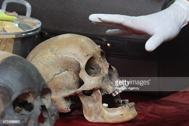 Customs and Excise officers show objects of cultural heritage in the form of a human skull that is believed to originate from the Dayak tribe in...