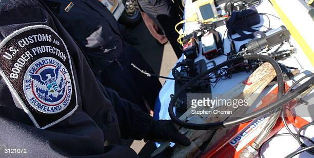Customs inspectors prepare a variety of inspection devices used to examine incoming freight at the docks March 22, 2004 in Jersey City, New Jersey....