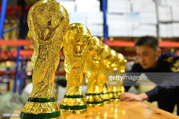 """April 16: Customs officer deal with fake """"Jules Rimet Trophy"""" on April 16 in Yiwu, Zhejiang Province of China. 1020 fake """"Jules Rimet Trophy"""" are..."""