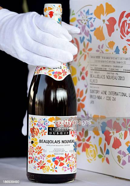 A customs officer inspects a bottle of Georges Duboeuf Beaujolais Nouveau wine at Haneda Airport in Tokyo Japan on Tuesday Nov 5 2013 Japanese...