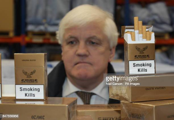 Customs officer Mick Hannon unpacks some of the more than 38 million contraband cigarettes worth almost 15 million euro have been seized by Customs...