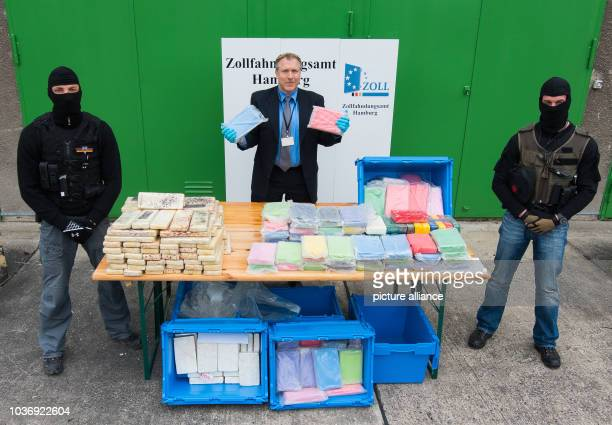 Customs officer Niels Hennig presents seized packages of the drug cocaine in Hamburg Germany 23 April 2015 The customs office discovered 257 kg of...