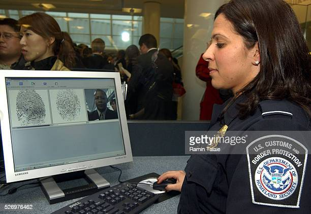 Customs officer takes biometrics data from a foreign traveller entering the United States through JFK International Airport. Department of Homeland...
