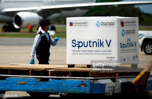 Customs officer walks past a container carrying part of the second batch of 300,000 doses of Sputnik V vaccine from Russia after it's arrival at...