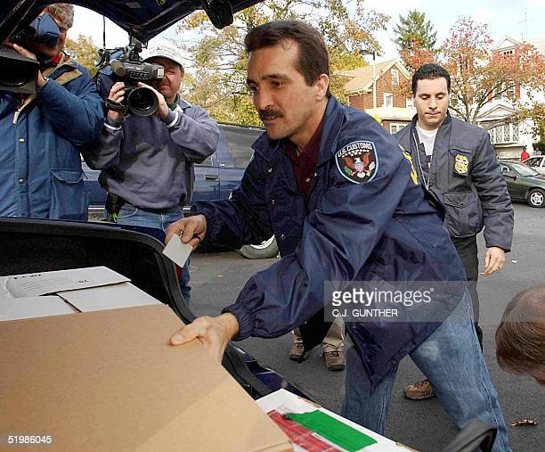 Customs Officers and Internal Revenue Service Investigators load items seized at the Dorchester Massachusetts offices of the alBaarakat North...