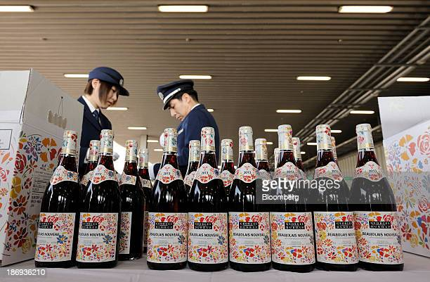 Customs officers inspect bottles of Georges Duboeuf Beaujolais Nouveau wine at Haneda Airport in Tokyo Japan on Tuesday Nov 5 2013 Japanese appetite...