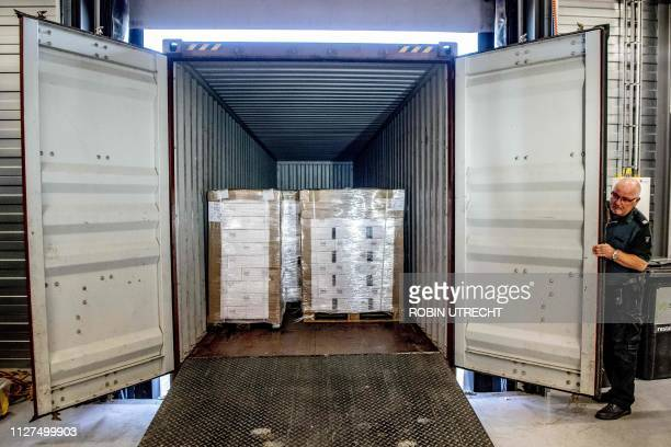 A customs official displays a container with 90000 bottles of vodka after it was intercepted in the port of Rotterdam on February 26 2019 Customs...