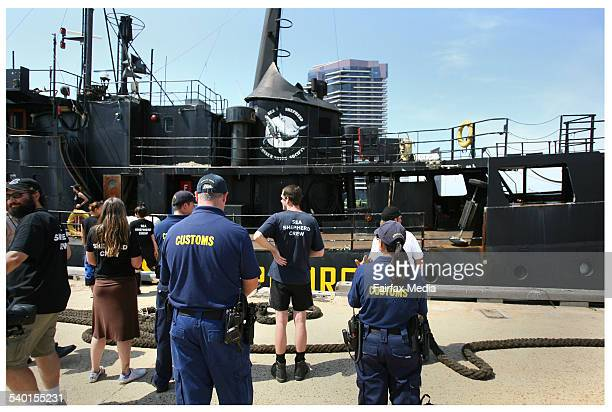 Customs officials prepare to board the unregistered Farley Mowat which berthed at Docklands Melbourne Port after months at sea disrupting Japanese...