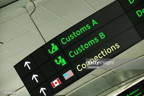 customs sign at an airport - customs stock pictures, royalty-free photos & images