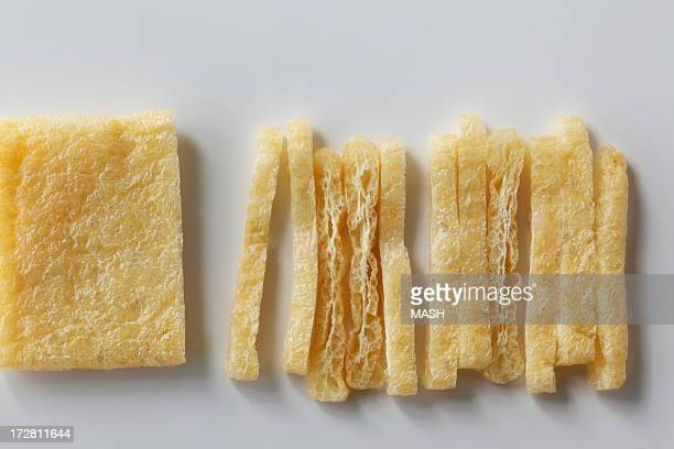 cut aburaage,a deep-fried tofu - aburaage stock pictures, royalty-free photos & images